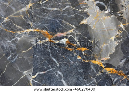 yellow and white patterned structure of dark gray marble (Russia Gold) background texture for product design.