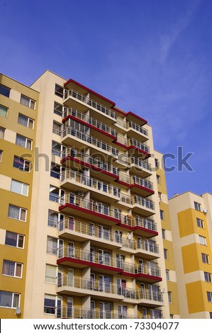 Yellow apartment buildings in a blue sky background in Vilnius, Lithuania