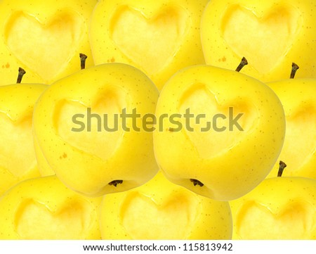 Yellow apple with heart shape.background of apples