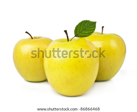 yellow apples with leaves isolated on white - stock photo