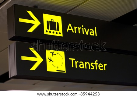 yellow arrivals & transfer sign at a international airport