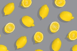 Yellow background. Lemon fruit on gray background . Flat lay, top view, copy space. Color 2021 illuminating and Ultimate Gray.
