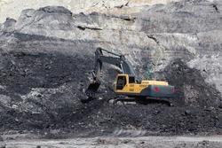 yellow backhoe work in coalmine