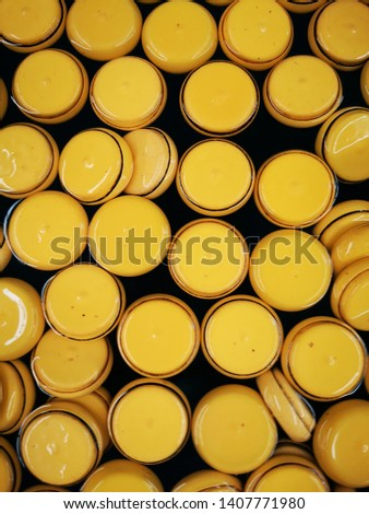 yellow ball, yellow circle, yellow plastic.