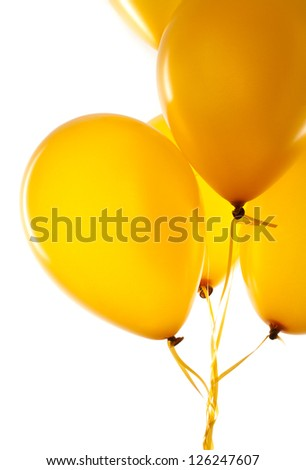 Yellow balloons on light background