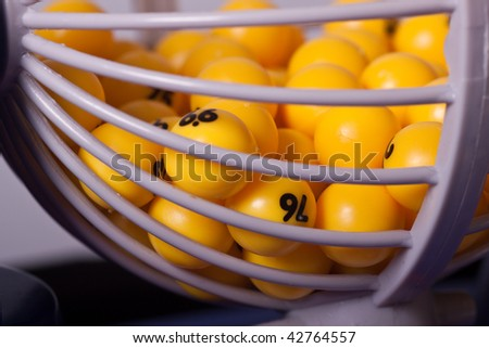 Yellow balls in a basket used for random selection.