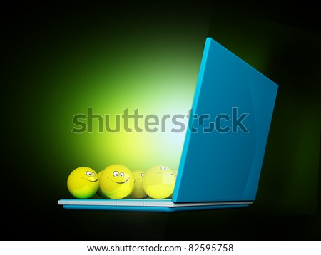 Yellow balls on laptop on dark green background