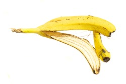 yellow banana peel on a white isolated background