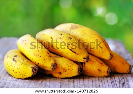 Yellow bananas on table - stock photo