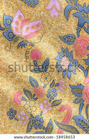 stock photo : Yellow batik sarong with floral motif and a butterfly