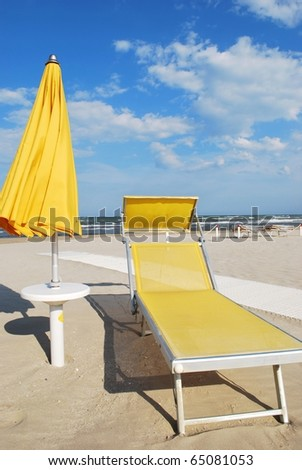 Yellow beach chair and umbrella, Rimini, Italy