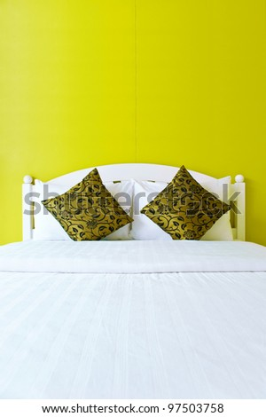 Yellow bedroom in a modern house - home interiors.