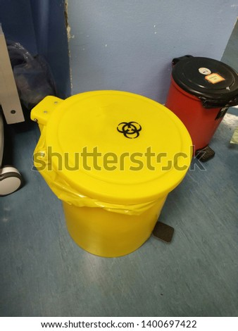 Yellow biohazard medical contaminated sharps clinical waste container  - Image