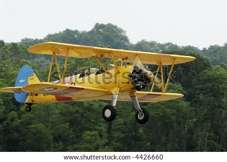 Yellow Biplane at airshow