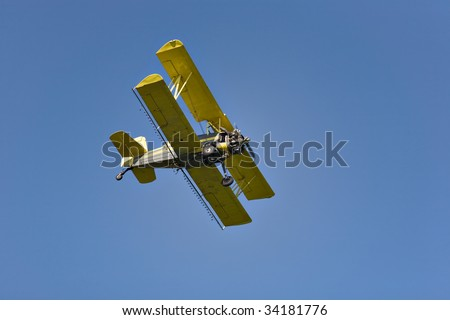 Yellow biplane, crop duster.