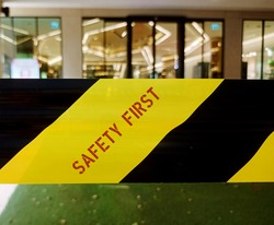 Yellow-black Barricade Tape ( caution, warning , danger or hazard tape) catch the attention of passersby with text SAFETY FIRST to prevent accidental entrance to that area