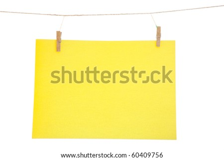 Yellow blank paper sheet on a clothes line. Isolated on white background.