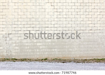 yellow block wall by gravel