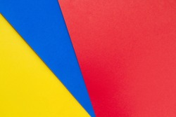 Yellow,blue and red papers background.Concept of primary colors