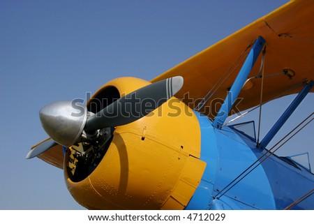 Yellow & blue Stearman biplane.
