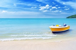 Yellow boat on a beach.