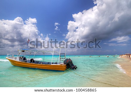 Yellow boat on the coast of Caribbean Sea - Mexico