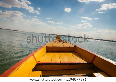 Yellow Boat on the Mekong River in Cambodia #1194879391