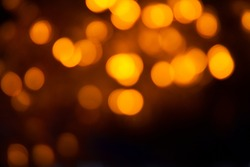 Yellow Bokeh of Light. Golden Bokeh of Light. Defocused light with black background. Night life light bokeh. Sparkle bokeh.