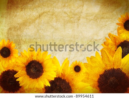 Yellow border made of beautiful bright sunflowers. Distressed vintage look. Summer concept.