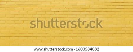 Yellow brick background. Yellow brick wall texture. Abstract yellow cement texture and background. brick wall. Poster Birck. Wall pattern. A victorian old brick wall showing signs of wear.