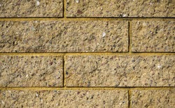 Yellow bricks wall. Bricks texure. Brick background.