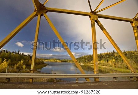 Yellow Bridge in Northern Manitoba Canada - stock photo