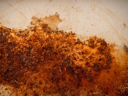 Yellow brown rust and dirt on white enamel. Rusted brown and white abstract texture. Corroded white metal background. Rusty white painted metal wall.