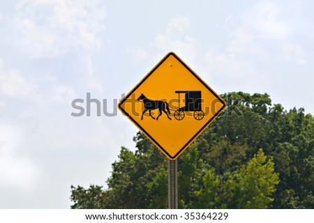 Yellow buggy and horse street sign displayed in Amish country.