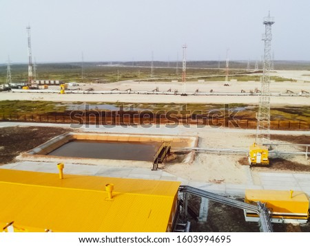 Yellow building - Oil pumping station for oil pumping. Oilfield facilities