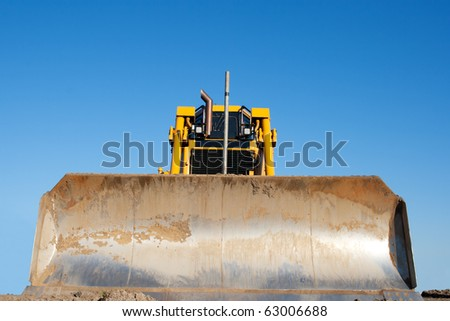 Yellow bulldozer at work