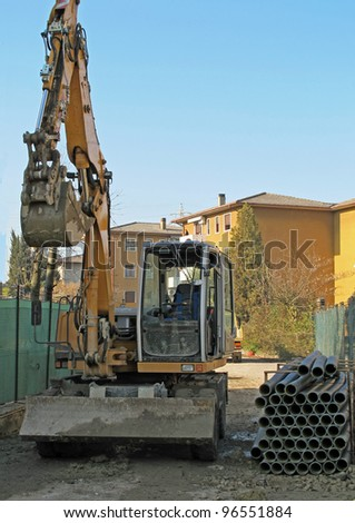 yellow bulldozer during the excavation in a road construction site