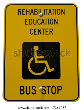 Yellow bus stop sign with handicap symbol - stock photo
