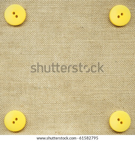 Yellow buttons on the beige fabric