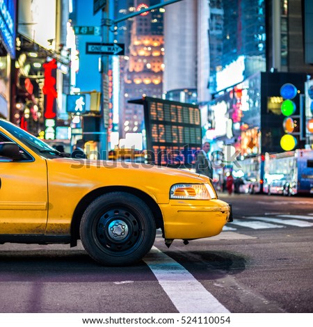Yellow cabs in Manhattan, NYC. The taxicabs of New York City at night Time Square.