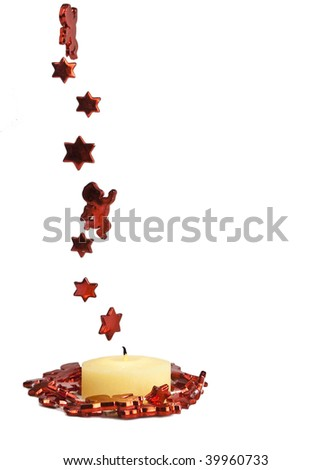 Yellow candle decorated with red stars