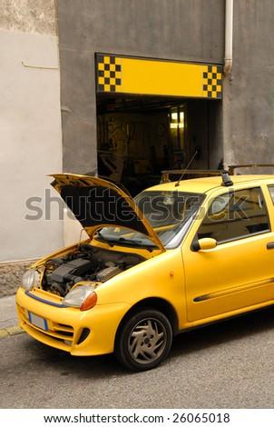 Yellow car near the repair booth
