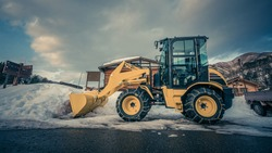 Yellow Car Plow For Sweeping Snow