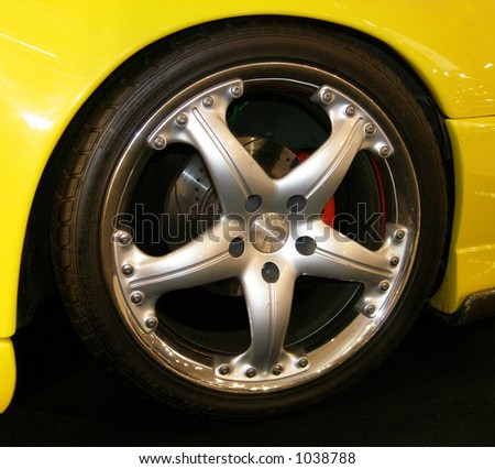 Yellow car with alloy wheel rim