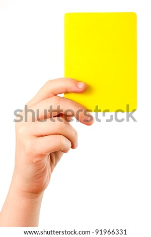 Yellow card in a hand in front of a white background