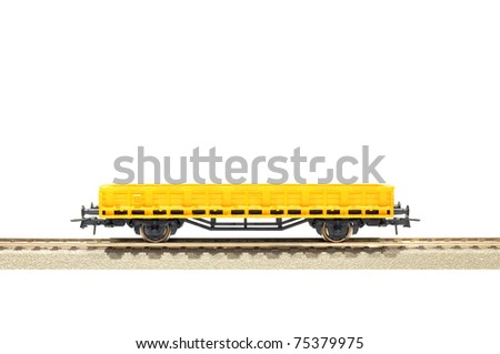 yellow cargo carriage railroad toy model, H0 scale, isolated on white with clipping path