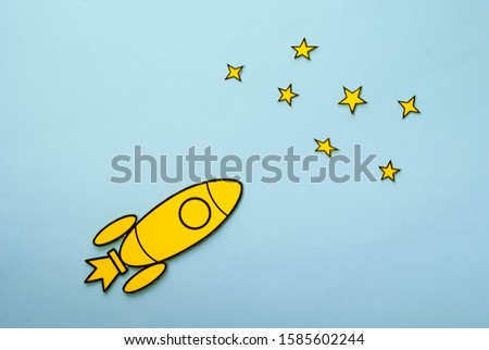 Yellow cartoon rocket flying through space with copy space