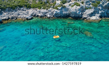 Yellow catamaran on the beautiful turquoise sea water. Pedal boat. Active rest on the water. #1427597819