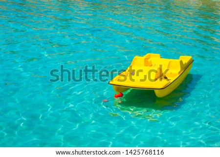 Yellow catamaran on the water. Pedal boat. Active rest on the water. Hobby. Leisure. Entertainment. Summer vacation. #1425768116