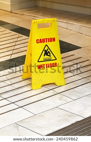 Yellow caution sign for wet floor warning